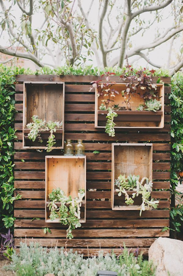 rustic wood pallets plants in boxes wedding backdrop