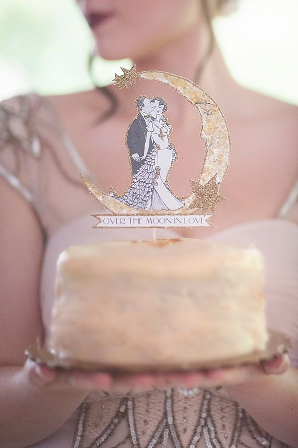 Over the Moon in Love Art Deco Wedding Cake Topper | Ashlee Mintz Photography | Golden Goddess - Crystal, Gold, and Champagne Bridal Shoot with Vintage 1920s Style