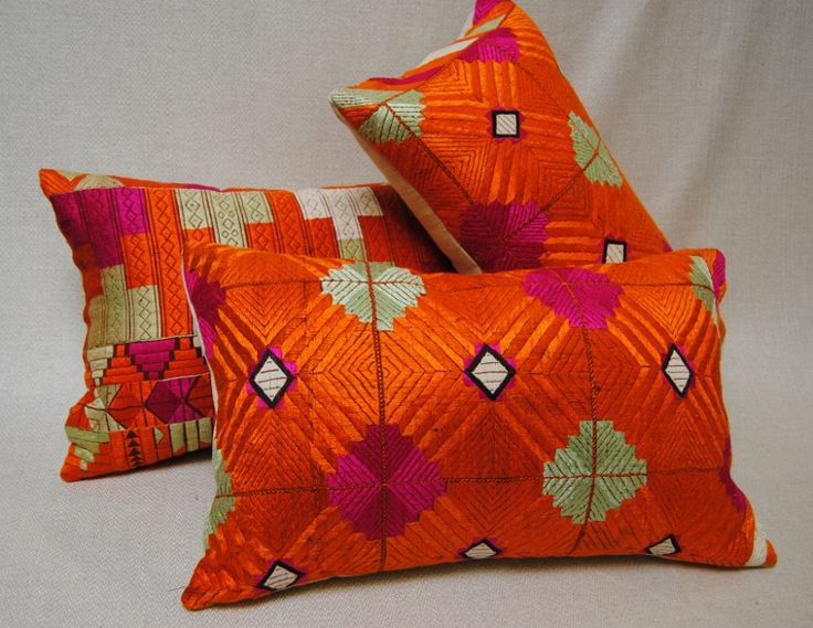 Vivid color on custom Phulkari Bagh pillows from Punjab, Indian wedding shawl.  Hand loomed khadi shawl with brightly colored silk embroidery.  Maison Suzanne Gallery.