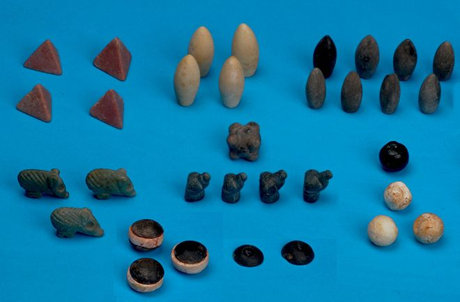 Oldest Gaming Tokens Found in Turkey.  Small carved stones unearthed in a nearly 5,000-year-old burial could represent the earliest gaming tokens ever found, according to Turkish archaeologists who are excavating early Bronze Age graves.  Found in a burial at Başur Höyük, a 820- by 492-foot mound near Siirt in southeast Turkey, the elaborate pieces consist of 49 small stones sculpted in different shapes and painted in green, red, blue, black and white.