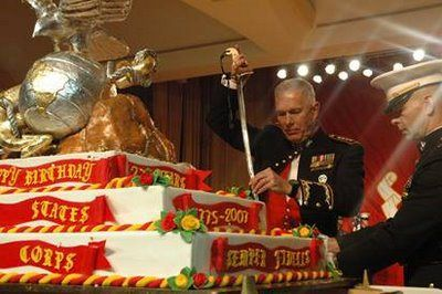 USMC Birthday Ball, Commander cutting the cake with his ceremonial sword (http://activerain.com/)