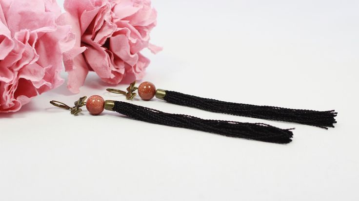 Long earrings with golden sand beads.