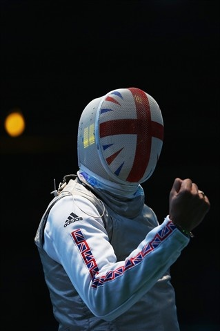 Best Of London: Day 9 - Slideshows | James-Andrew Davis of Great Britain celebrates beating Alaaeldin Abouelkassem of Egypt during the Men's Foil Team Fencing on Day 9.  (Photo: Hannah Johnston / Getty Images) NBC Olympics