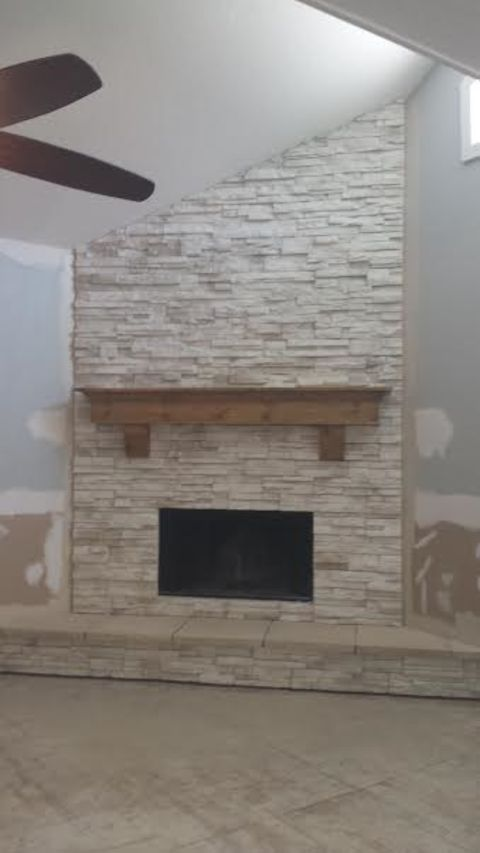 Transitional Fireplace with stacked stone facing