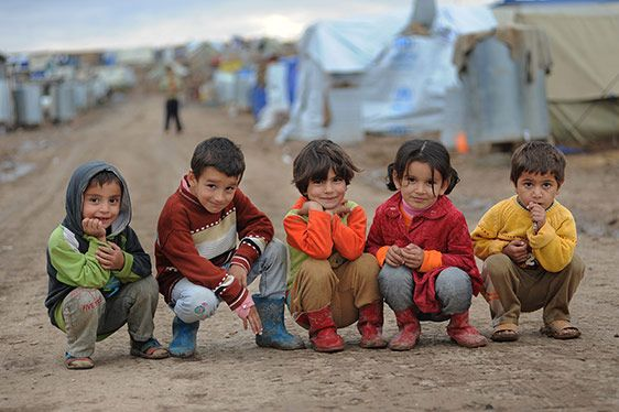 Syrian children sit on the ground in Domiz refugee camp, northern Iraq