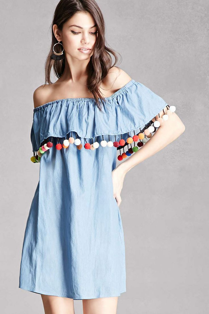 A chambray mini dress featuring an off-the-shoulder neckline, a flounce layer with beaded and pom pom accents, and short sleeves. This is an independent brand and not a Forever 21 branded item.
