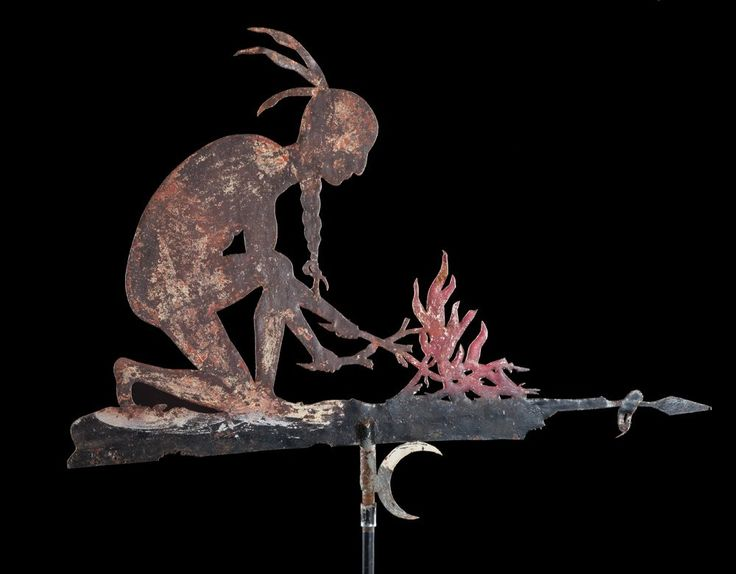 A spectacular sheet steel painted weather vane of a Native American crouched at the fire. Circa late 19th century.
