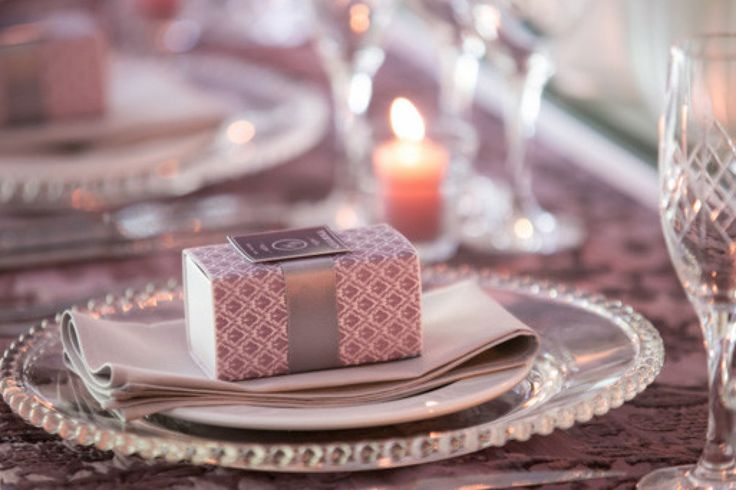 We created pretty damask printed macaroon boxes for Charle and Nicolai's wedding which was customised with a ribbon and paper seal with their names on it. http://www.secretdiary.co.za #favorbox #giftbox #paperbox #macaroonbox #printedbox #giftfavour