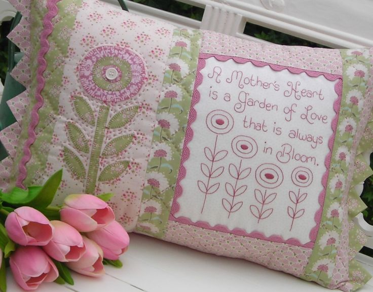 """""""A Mother's Heart"""" by Sally Giblin of The Rivendale Collection.  Verse reads: A Mother's heart is a garden of love that is always in bloom. Finished cushion size: 14"""" x 22½"""". #TheRivendaleCollection stitchery, appliqué and patchwork patterns. www.therivendalecollection.com.au"""