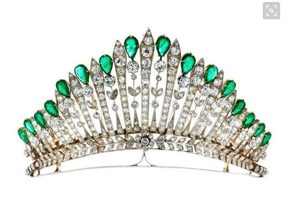 A diamond and emerald belle epoque tiara, 1910. Designed with the diamond pinnacles of a fringe tiara alternating with foliate pinnacles topped with pear-shaped emeralds, all rising from a laurel leaf band. This piece fetched EUR30,000 at auction