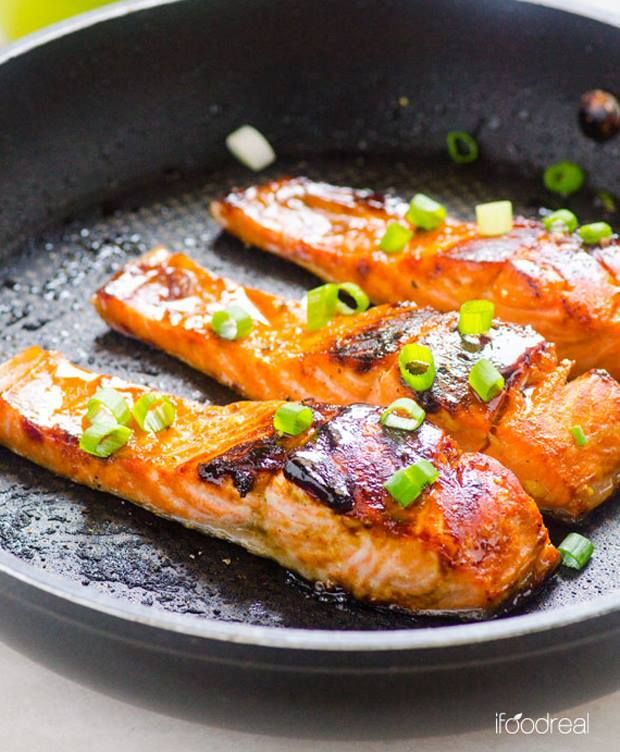 I am trying this tomorrow!   Easy Crispy Honey Garlic Salmon  By: iFOODreal   Ingredients: 2 tbsp honey  1 tbsp lemon/lime juice (freshly squeezed is best)  2 - 3 large garlic cloves, crushed  1/2 tsp salt  1/2 tsp ground black pepper  6 x 3 oz each salmon fillets, skin on/off  1 - 2 tsp coconut oil or extra virgin olive oil 2 green onions, finely chopped  Directions: 1.In a small bowl, whisk together honey, lemon/lime juice, garlic, salt and pepper. Place salmon fillets in a large ...