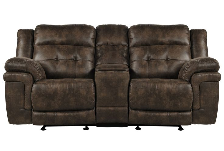Deeply padded arms and cushioned headrests lend a plush feel to the Carver power reclining console loveseat, while tailored tufting on the back cushions and chocolate-hued upholstery offer an overall look of sophistication. Shop online now. #LivingSpaces