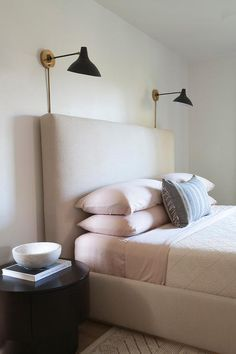 bedroom, pale, pastel, beige, pink, upholstered headboard, minimalist, sconce, midcentury, modern, grey, gold, black, contemporary, bedside table, bed linen, interior design