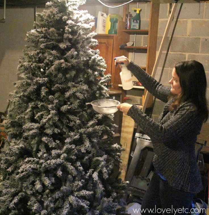 Flocking an artificial Christmas tree - you can totally DIY this