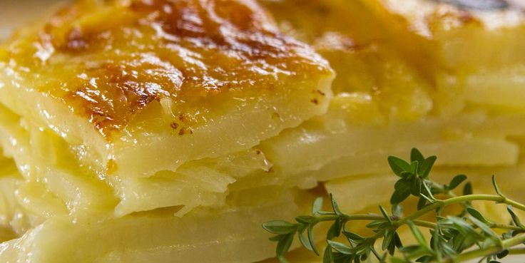"""CHEESY POTATO GRATIN Delicious layers of creamy cheesy potatoes with a hint of herb and garlic A gratin is a French culinary word meaning """"Browned crust"""".  It's either made using, cheese, eggs or breadcrumbs and browned under a grill/broiler until it forms a golden crust.  This potato dish is baked in an oven and still achieves a beautiful golden crust that will leave you wanting more."""