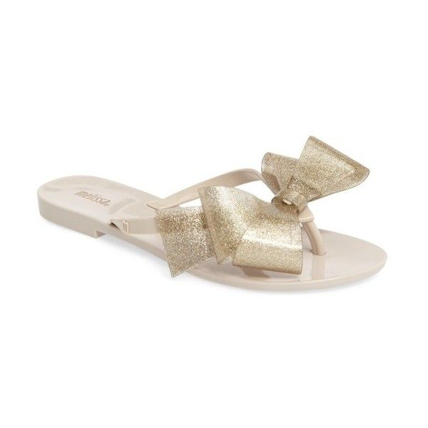 Women's Melissa Harmonic Bow Iii Flip Flop (732.155 IDR) ❤ liked on Polyvore featuring shoes, sandals, flip flops, beige gold glitter, melissa flip flops, melissa sandals, glitter sandals, beige sandals and glitter flip flops