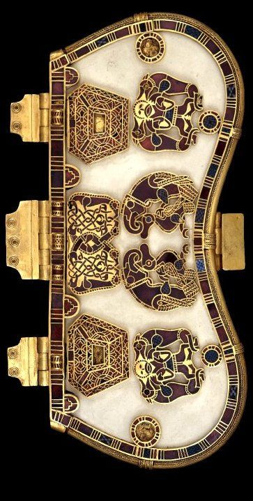Sutton Hoo Purse..The base was made of bone or ivory overlain with seven decorative plaques worked in gold with cloisonne garnets and millefiori glass. The purse held gold coins and ingots