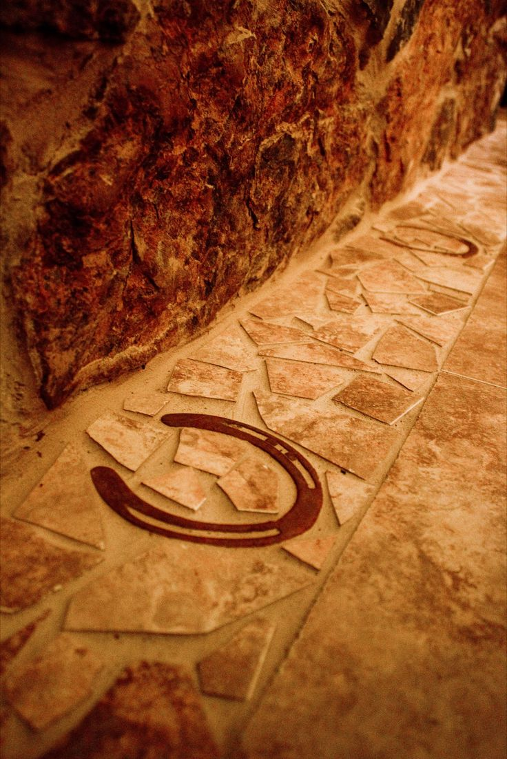 Embedded horseshoes in stonework - great way to add rustic character!