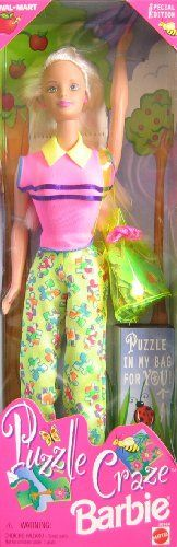 """Puzzle Craze Barbie Doll w Puzzle For YOU! - Wal*Mart Special Edition (1998). Wal*Mart Special Edition Puzzle Craze Barbie Doll, Puzzle in My Bag For YOU! is a 1998 Mattel production. Includes: 11.5"""" Barbie Doll w/long blond hair & pale green eyes. Doll wears pink button Earrings & Finger Ring, a pink Top w/yellow collar & blue stirpes across bust & blue thread trim at waist & sleeve openings, a pair of ywllow w/green, orange, blue, purple & white puzzle pattern Pants, & doll comes w/Shoes…"""
