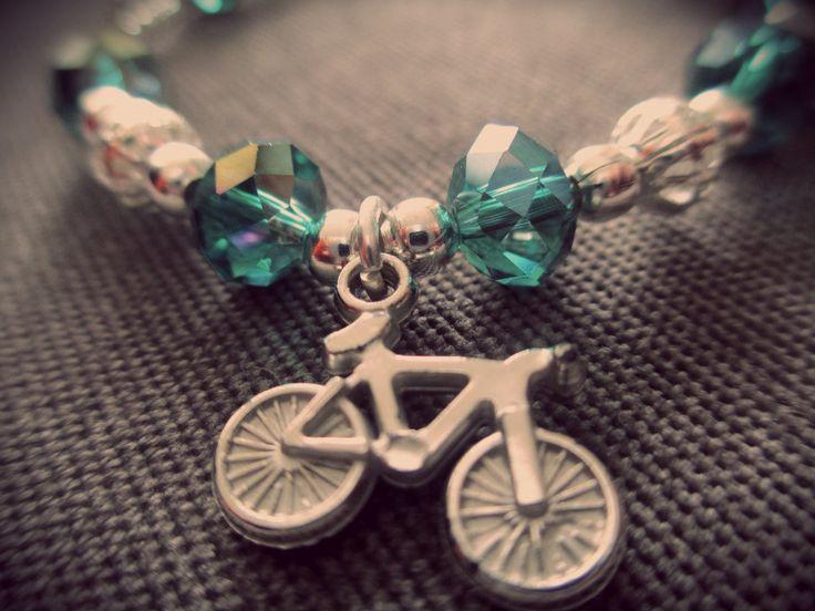 Original Pulsera plateada con muranos turquesa y dije de bicicleta