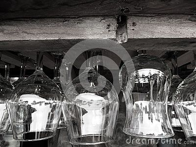 Glass cups upside down on a wooden bar