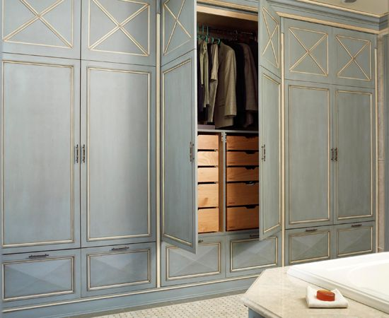 In this master bath, a wall of custom-designed closets and drawers eliminates the need for a separate dressing room.