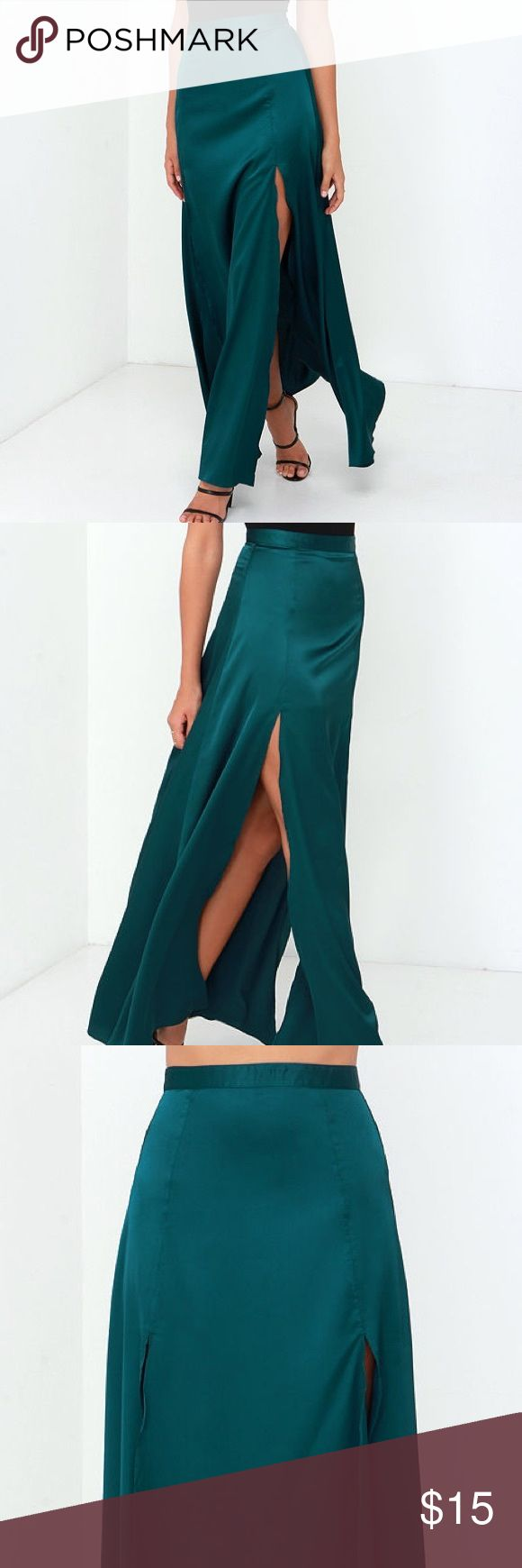 """RISE OF DAWN SPLIT SECOND DARK TEAL MAXI SKIRT Satiny woven fabric falls from a banded waist, into a flowy maxi skirt with two high, sultry side slits. Fastens at back with a small button closure and hidden zipper. Unlined. 100% Polyester. HandMachine Wash Cold.  Fit:fits true to size. Floor length.Size small measures 43"""" from top to bottom. Waist: Fitted - very fitted at natural waist. Hip: Loosely Fitted. Fabric: Fabric has no stretch. Height: 5'8"""" Bust: 33"""" Waist: 24"""" Hip: 34"""" Wearing…"""