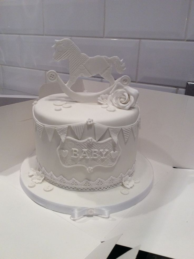 White baby shower rocking horse cake