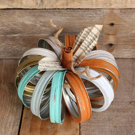 Bring on fall with shabby chic pumpkins made from recycled mason jar lids! Each pumpkin is unique!  - Painted with chalk paint and distressed in several colors: teal blue, off-white, orange, gray, rustic blue, along with some non-painted lid rings that have a gold or white color ~ Each one has a unique combination of lids so that none of them are exactly the same!  - Made from recycled materials (canning jar lids, cinnamon sticks, & book pages) which embellish the their shabby chic style ...