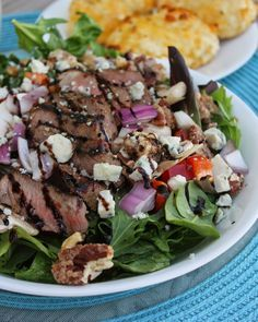 Sliced Steak Salad with Creamy Horseradish Dressing--hands down the best salad I have ever made!! This is unlke any steak salad you've had in the past. This salad has thinly sliced steak, gorgonzola cheese, red peppers, candied pecans, red onions, balsamic glaze and drizzled with creamy horseradish dressing. This is a MUST try salad for this summer! By dealstomealsblog.com