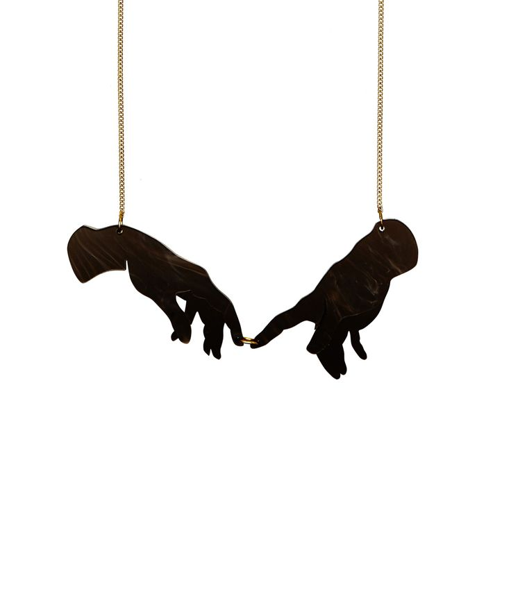 SS16 Creation of Adam Necklace - Inspired by the countless parodies of Michelangelo's iconic fresco in the Sistine Chapel, this masterpiece is recreated to form the Creation of Adam Necklace. These iconic hands are laser cut in black marble acrylic and hang from golden chain.