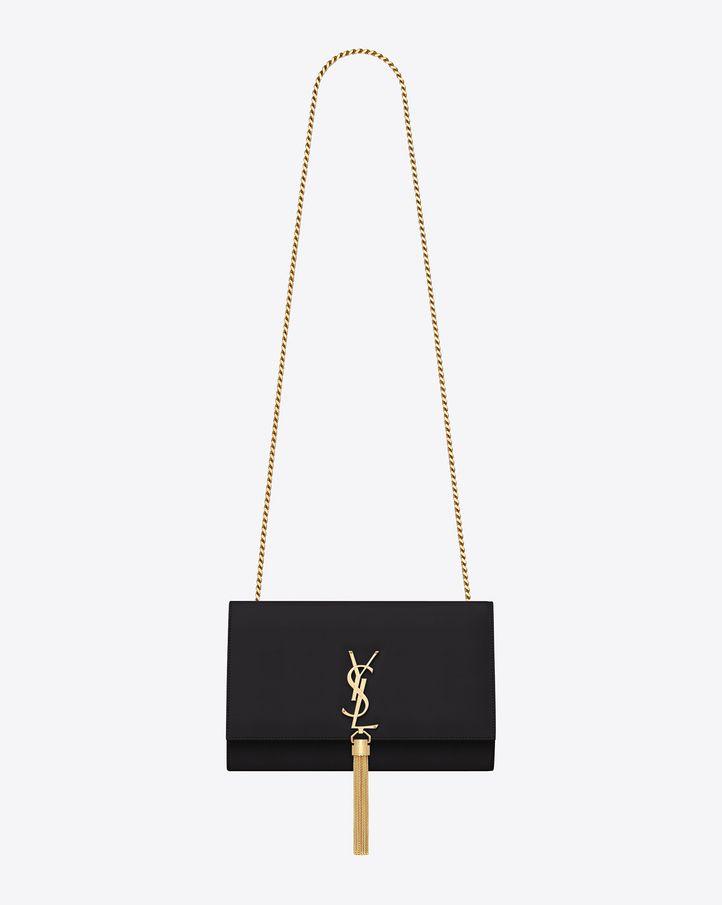 Classic Saint Laurent shoulder bag with interlocking metal YSL signature and metal chain tassel. $2190