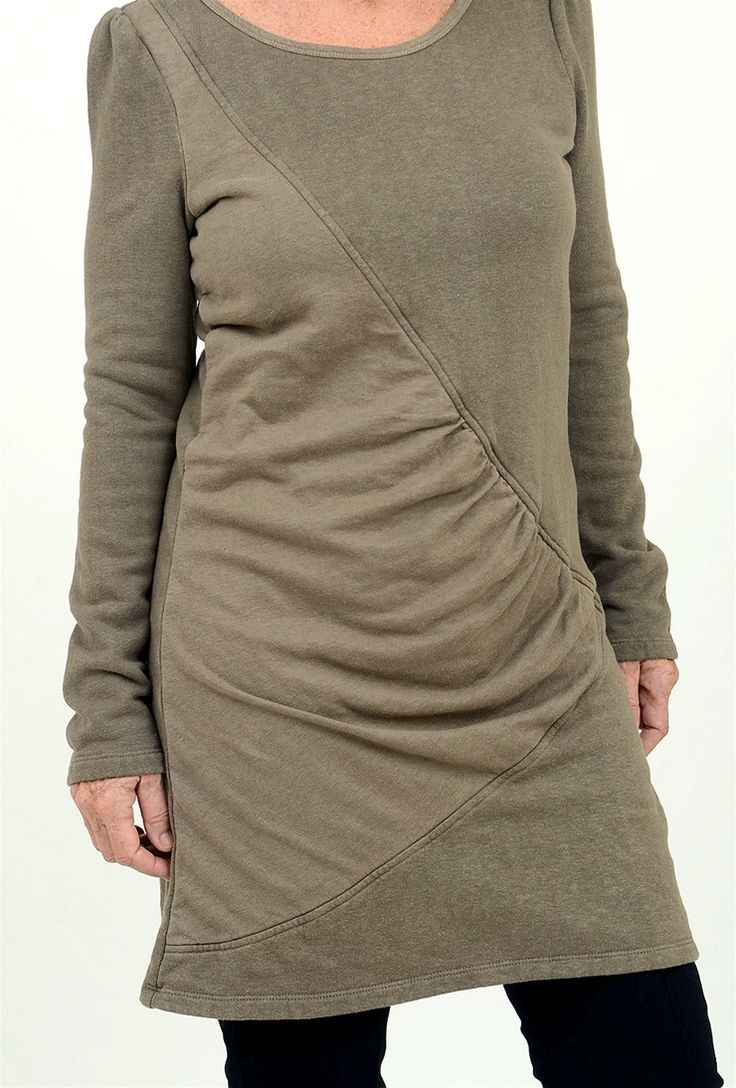Cozy is as cozy does in this fleece-tastic new tunic from Prairie U! Jem has puffed shoulders, a wide scooped neckline and a mid-thigh length. But the beauty of this baby is the bias-seamed inset of draping that creates a truly flattering fit.