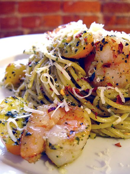 Shrimp Pesto Pasta -In medium-high heated pan,Add garlic and cook until fragrant, 20-30 seconds. Add tomatoes and cook for 1 minute. Add pesto and cook for another 1-2 minutes. Add pan seared shrimp and pasta to pan. Toss to incorporate all ingredients. Turn off heat. Add parsley, chili flakes, and salt and pepper to taste. Toss well. Right before serving add fresh grated Parmesan cheese. Enjoy!