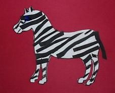 Cut out a zebra from white paper and lots of stripes from black paper to decorate him. Paste or tape the zebra on a piece of background paper and assemble him