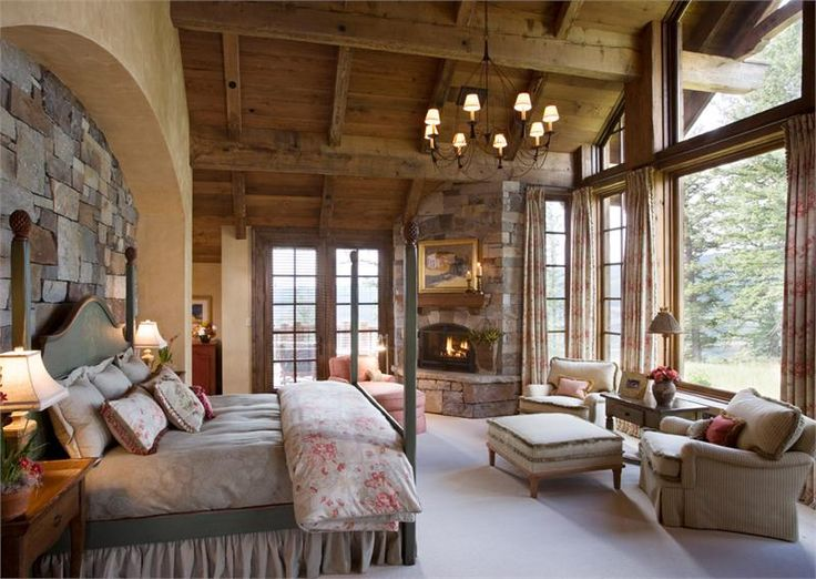 Rustic master retreat with fireplace and a lot of windows ...