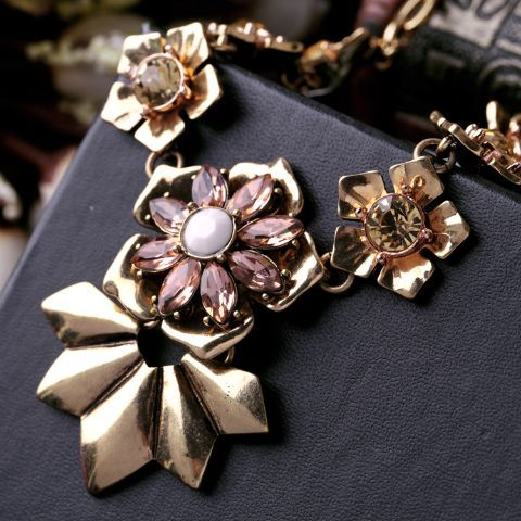 A sophisticated showstopper, this necklace with its gold plated flowers sits perfectly on your collar bone. Pair it with your formal or casual wear and it will enhance it. An ideal wear for a trendy evening party. The materials used for our jewellery are generally mixed metals, non-precious gemstones or acrylic spot materials .