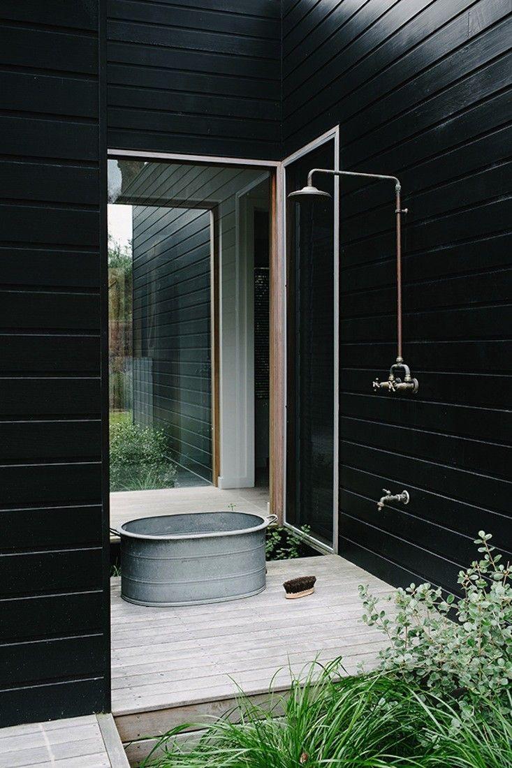 Black outdoor shower at designer Shareen Joel's Sorrento-beach-house | Remodelista