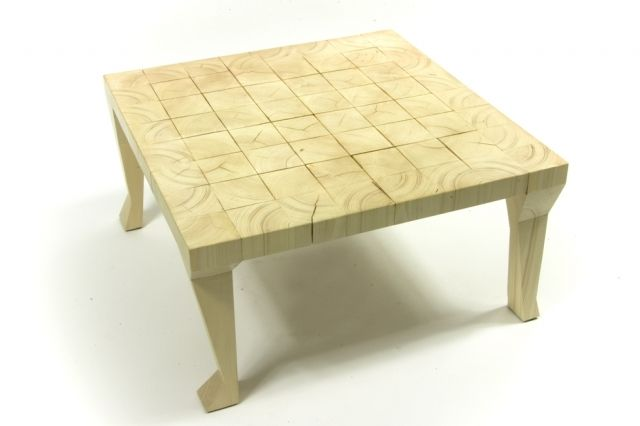 Coffee table on valgus legs, table's top made of 64 pieces of wood that began to react and  subtle breaks are result.  The effect is sensational! You can play chess on it…  Table's legs are different, each is cut in a different way.