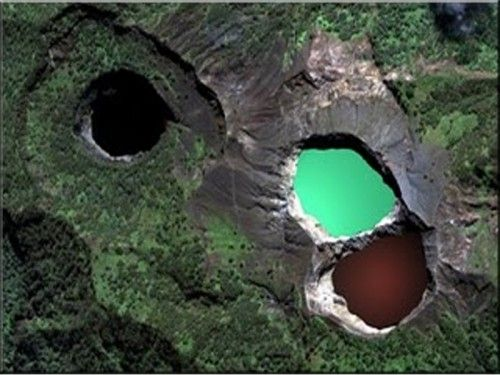The Lakes of Mount Kelimutu, Indonesia. The three lakes are different colors yet are at the crest of the same volcano. The colors change periodically. I am enamored with these lakes.