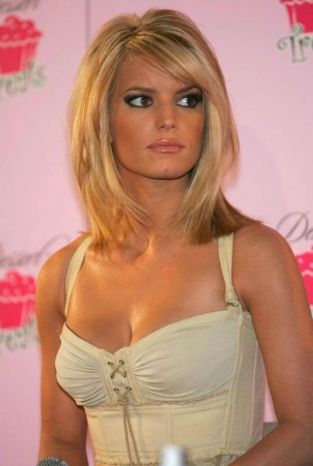 Jessica Simpson. Her haircut is cute here for short hair. I've had this cut with blonde hair and with red hair LOVE IT!!! (Alyssa)