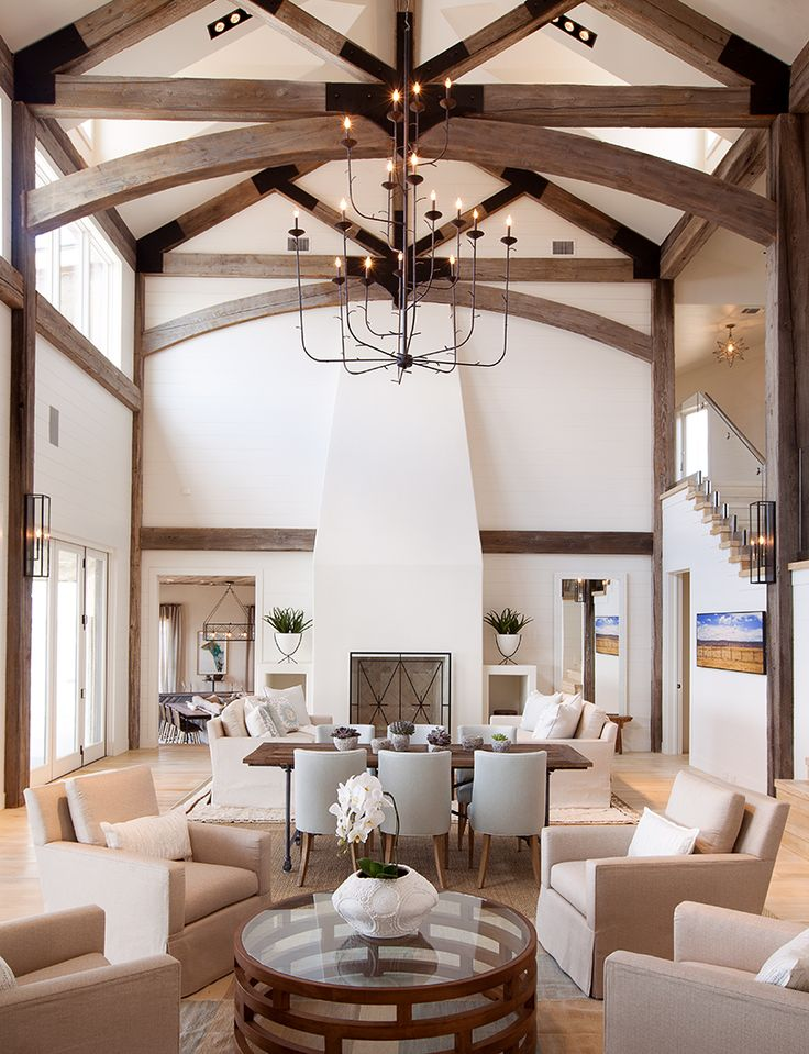 High-ceilinged great room with dark wood exposed beams and neutral furnishings | Tracy Hardenburg Design