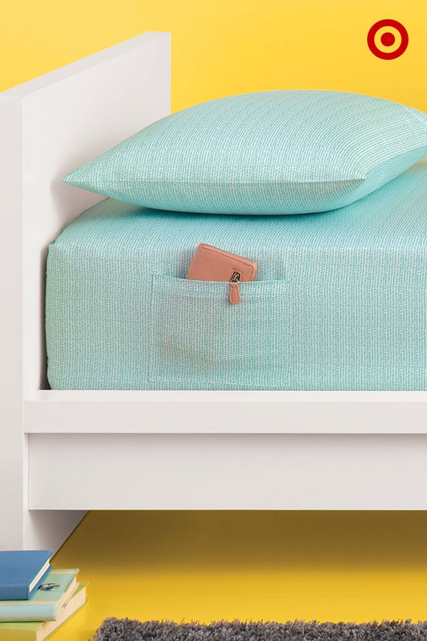 Who knew a fitted sheet could double as storage? This chic, microfiber set features a fitted sheet with a side pocket that's perfectly sized to hold your smartphone or reading material while you snooze. So great for small spaces!