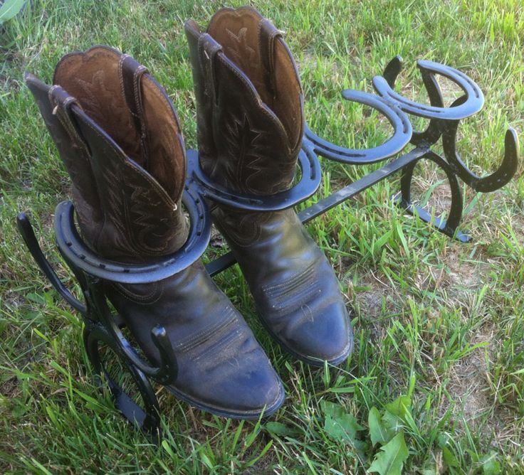 Snazzy boot rack welded from horseshoes.