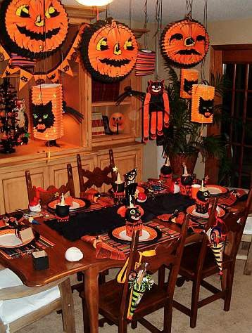 table set...paper pumpkins...cats lanterns hung....ready for Halloween...