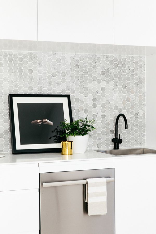 Grey splashback, black tapware, white cabinets and stainless steel appliances <3