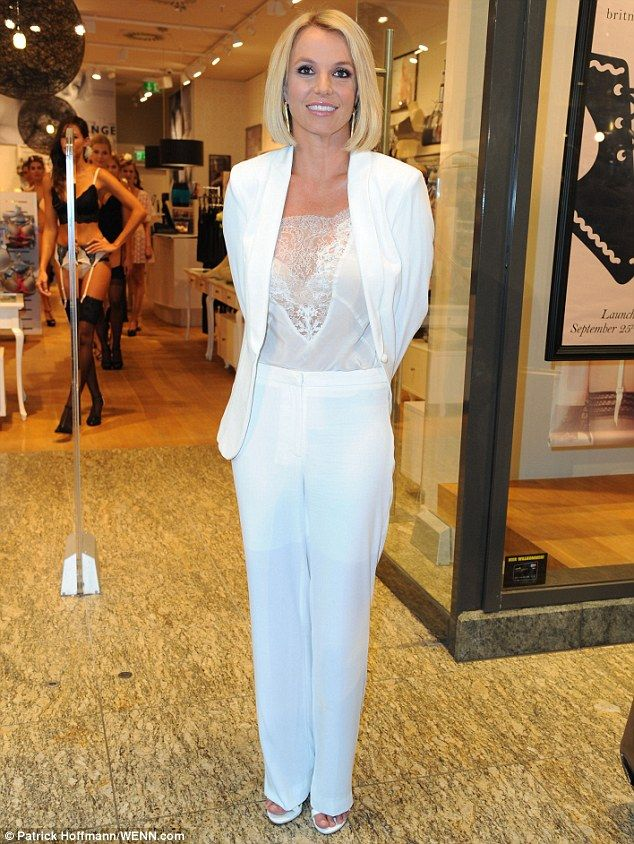 She's all-white: Britney Spears unveiled a new look when she promoted her lingerie line, The Intimate Collection, at theCentrO shopping mall in Oberhausen, Germany, on Thursday