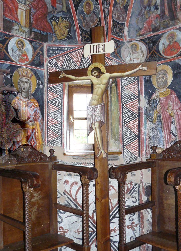 The Good Friday crucifix and frescoes on walls of the Main Temple (Katholikon) in St. Trinity Monastery (Moni Agias Triados), Meteora, Greece. Click on his image and on the next two images for a much close-up look.