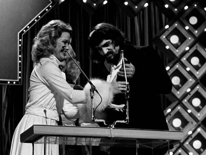 Tanya Tucker, left, congratulates a humble Waylon Jennings after his award of Male Vocalist of the Year. There had been speculation he would refuse any awards at the nationally-televised CMA Awards show at the Grand Ole Opry House. 10/13/1975