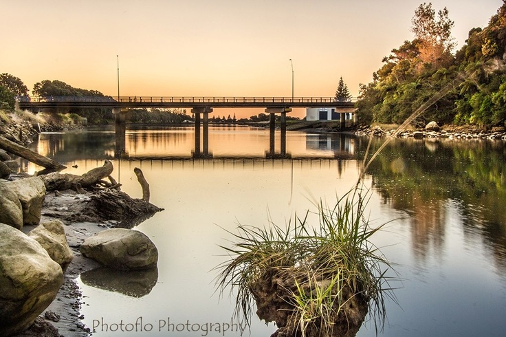Waitara Bridge at low tide as the sun goes down,